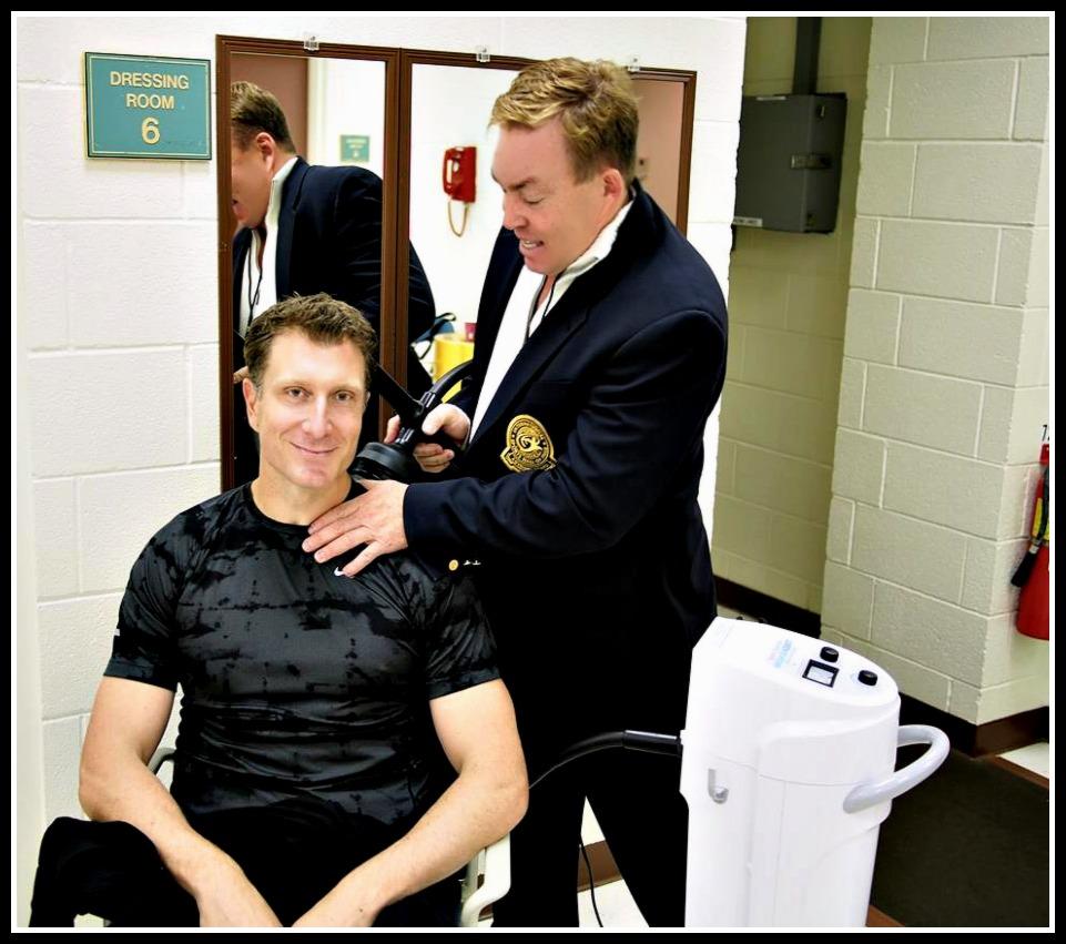 Dr James Stoxen DC using the MassageAssist with Simon Pryce
