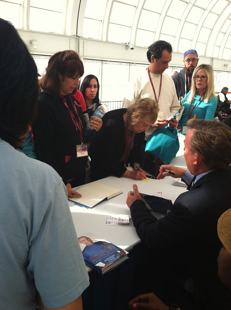 """Dr James Stoxen DC signing autographs for, """"How I Got My Wiggle Back"""" at the Health Freedom Expo 2013"""